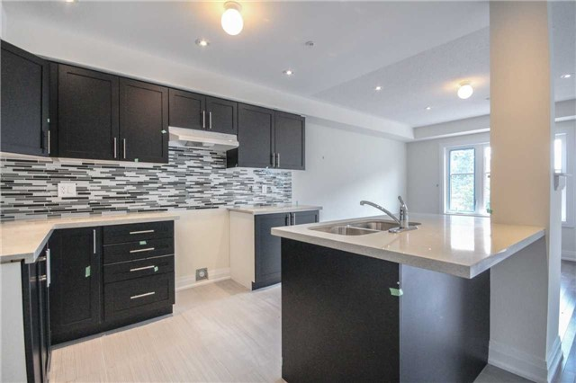 Townhouse at 16 Jerseyville Way, Whitby, Ontario. Image 14