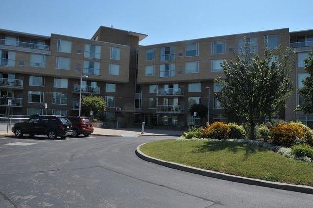 Condo Apartment at 452 Scarborough Golf Clu Rd, Unit 205, Toronto, Ontario. Image 1