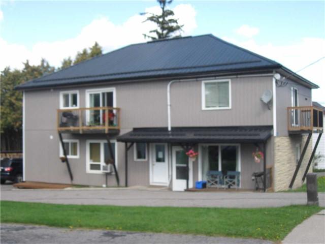 Fourplex at 15054 Simcoe St, Scugog, Ontario. Image 1