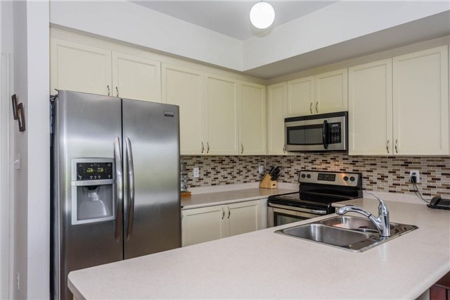 Condo Apartment at 6884 Fourteenth Ave, Unit 2B, Markham, Ontario. Image 2