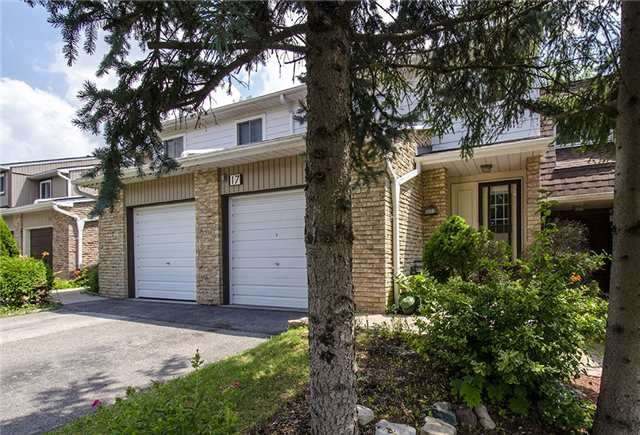 Condo Townhouse at 17 Romfield Crct, Markham, Ontario. Image 1