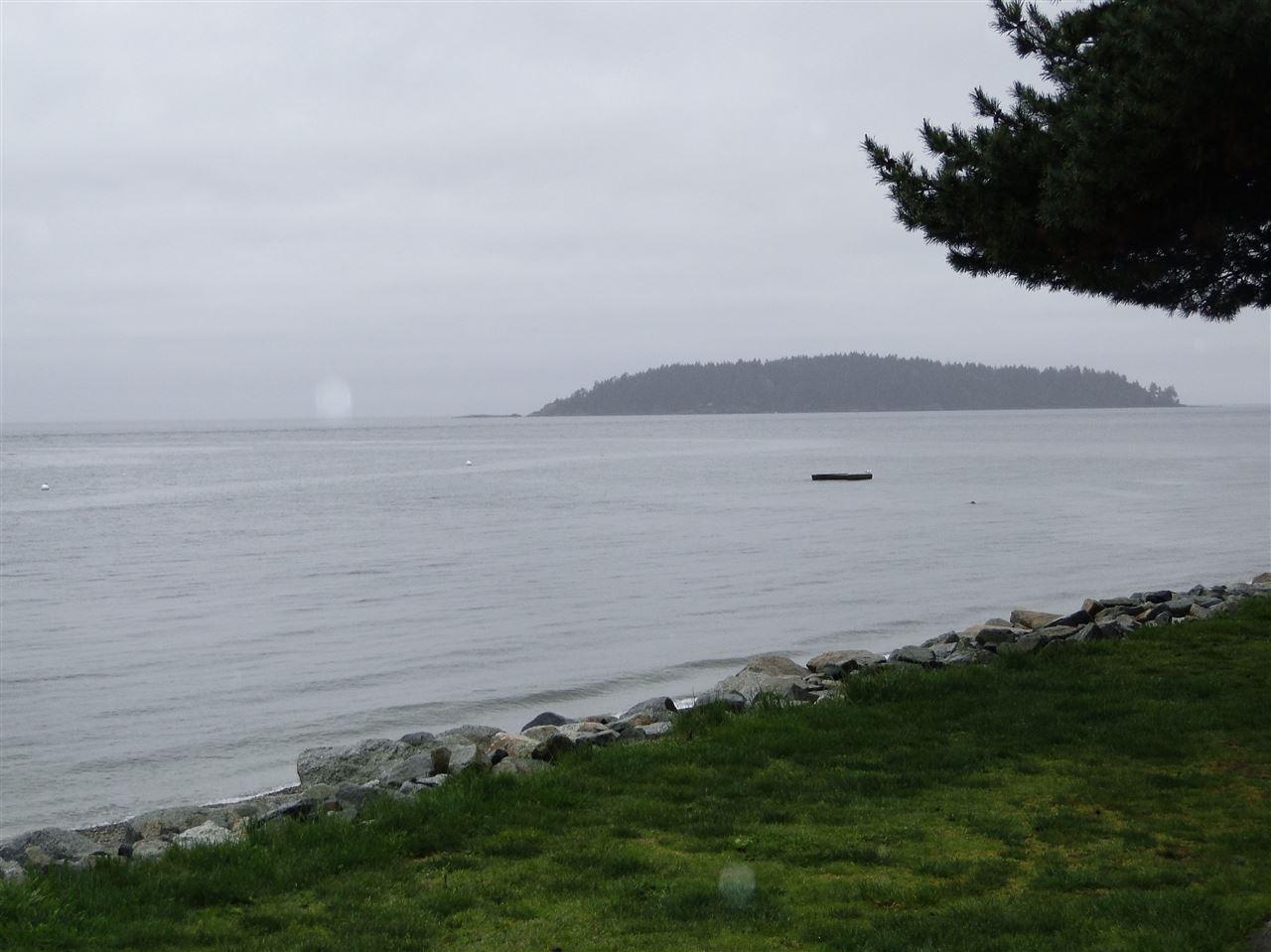Condo Apartment at 105 5477 WHARF AVENUE, Unit 105, Sunshine Coast, British Columbia. Image 2