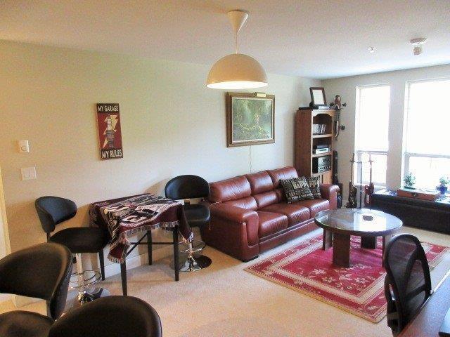 Condo Apartment at 217 1211 VILLAGE GREEN WAY, Unit 217, Squamish, British Columbia. Image 2