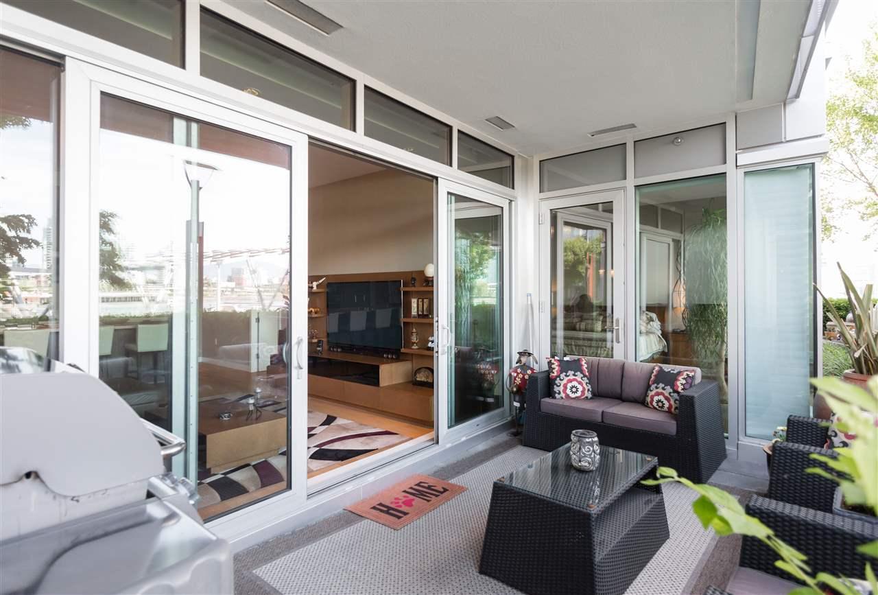 Condo Apartment at 102 151 ATHLETES WAY, Unit 102, Vancouver West, British Columbia. Image 5