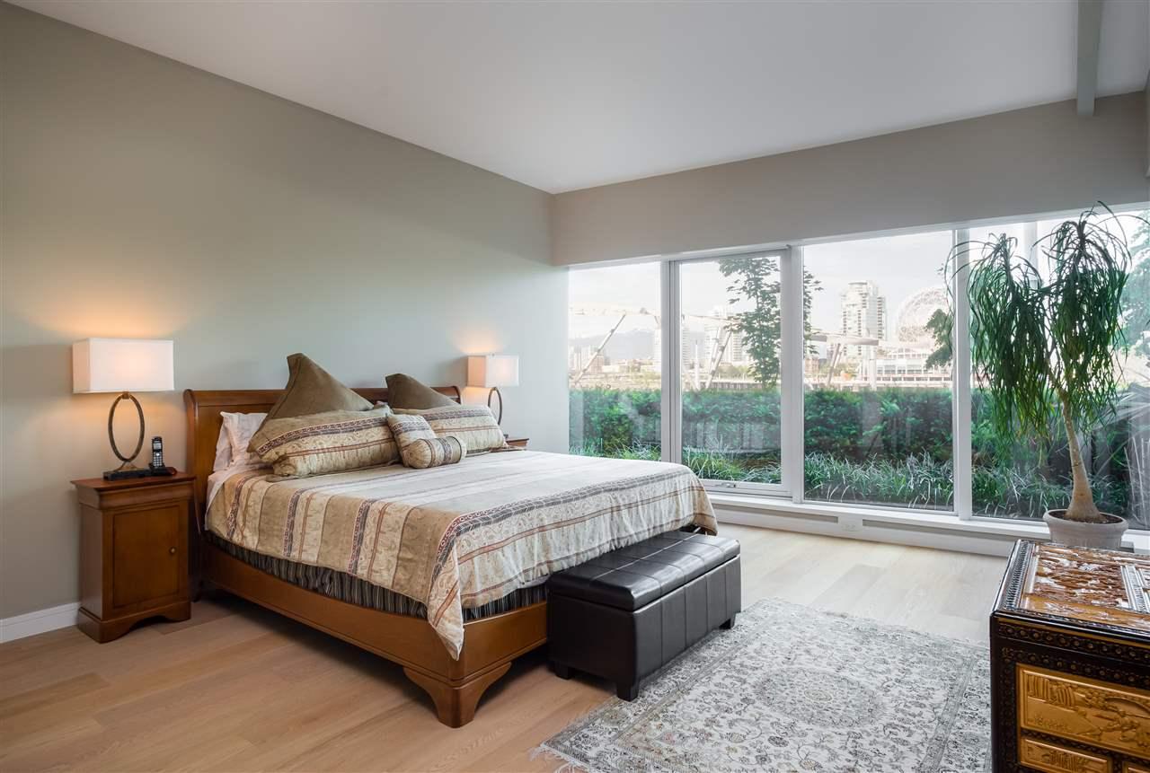 Condo Apartment at 102 151 ATHLETES WAY, Unit 102, Vancouver West, British Columbia. Image 15