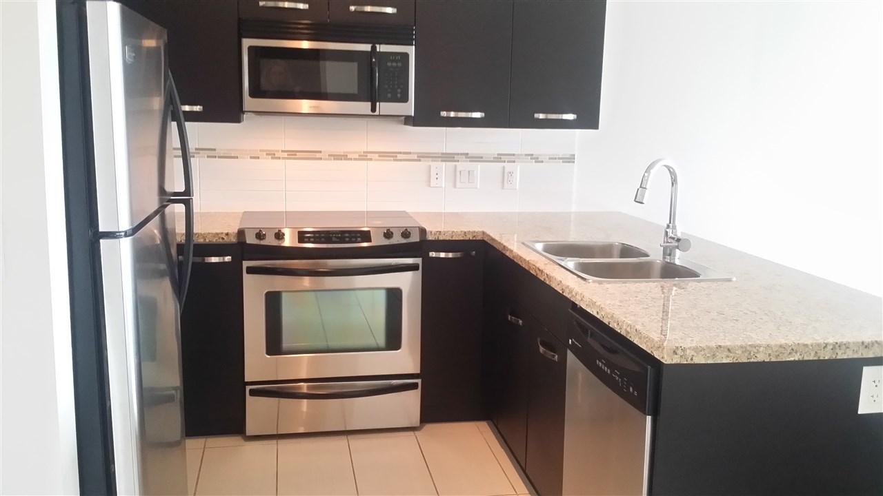 Condo Apartment at 105 33539 HOLLAND AVENUE, Unit 105, Abbotsford, British Columbia. Image 2