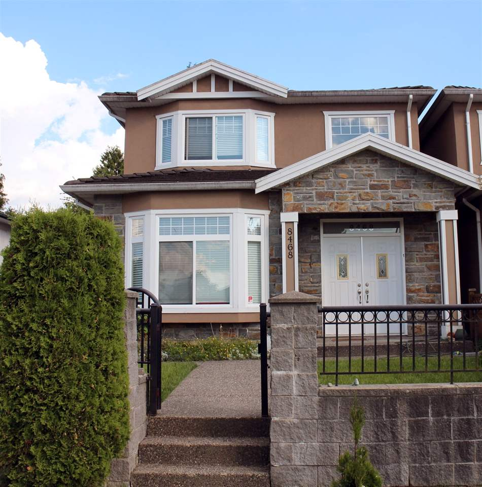 Half-duplex at 8468 14TH AVENUE, Burnaby East, British Columbia. Image 1