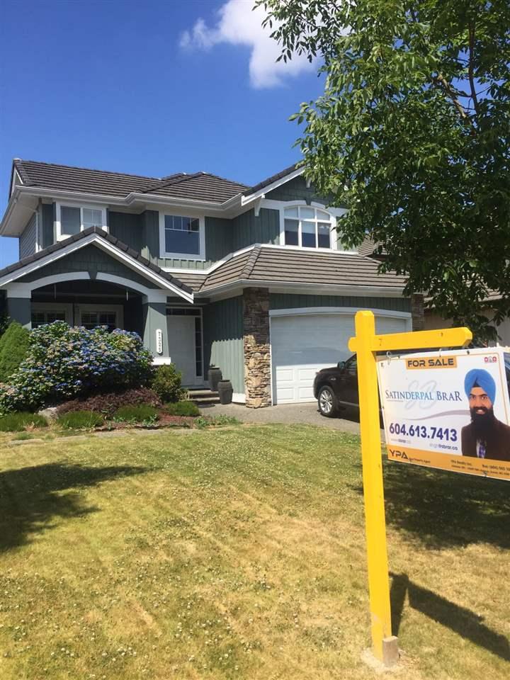 Detached at 7325 146A STREET, Surrey, British Columbia. Image 1