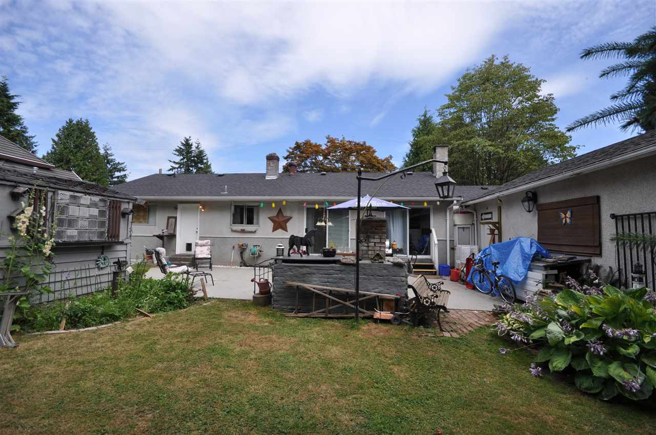 Detached at 8667 154A STREET, Surrey, British Columbia. Image 2
