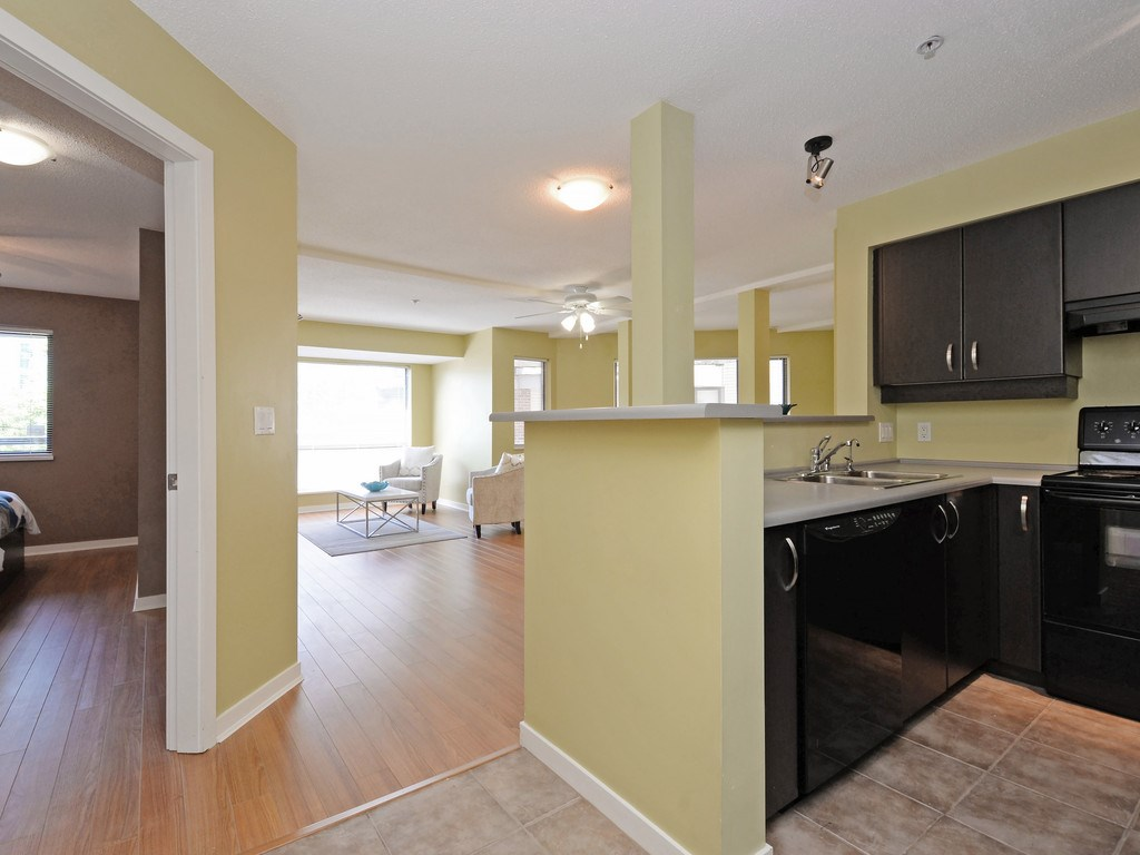 Condo Apartment at 215 10866 CITY PARKWAY, Unit 215, North Surrey, British Columbia. Image 2
