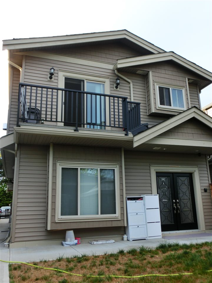 Half-duplex at 7230 11TH AVENUE, Burnaby East, British Columbia. Image 1