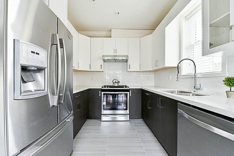 Half-duplex at 4361 FLEMING STREET, Vancouver East, British Columbia. Image 4