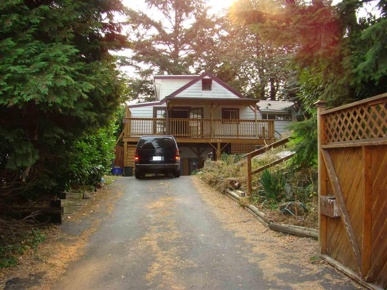 Detached at 11086 129 STREET, North Surrey, British Columbia. Image 1