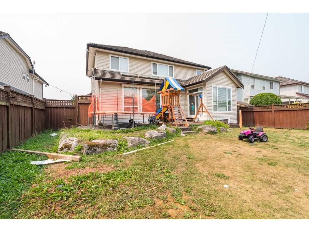 Detached at 7310 146 STREET, Surrey, British Columbia. Image 2