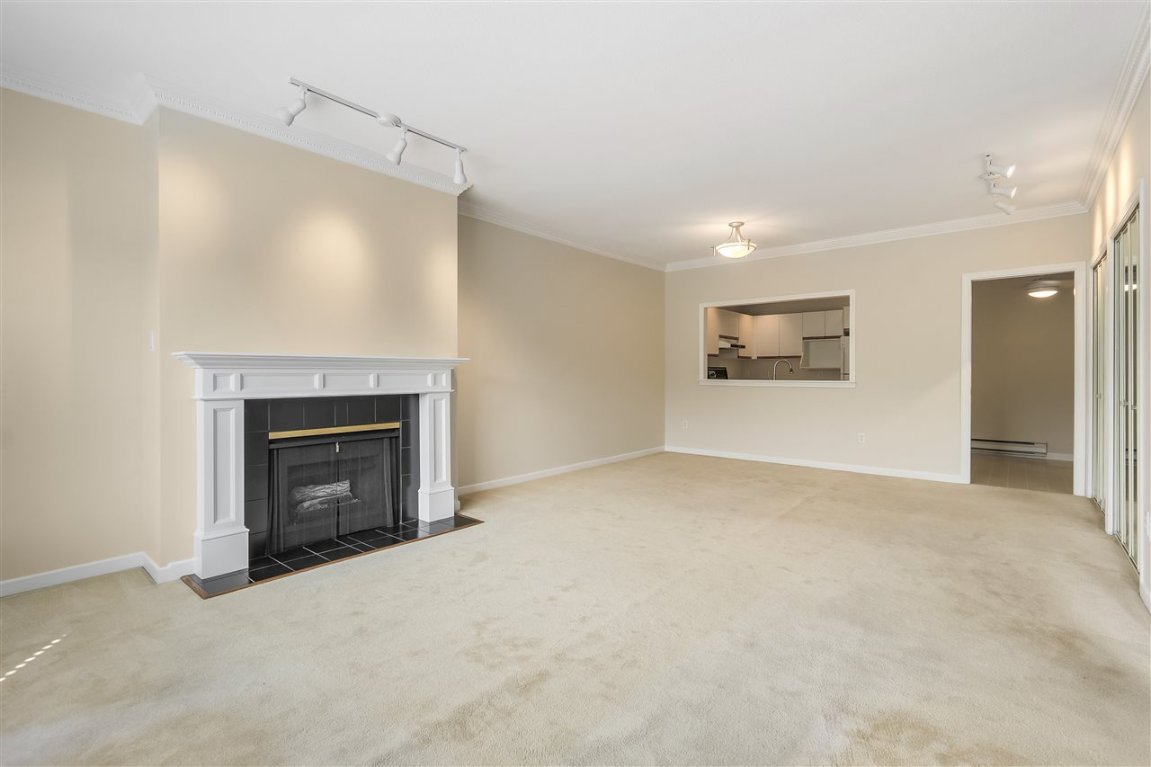 Townhouse at 102 250 E 11TH STREET, Unit 102, North Vancouver, British Columbia. Image 2
