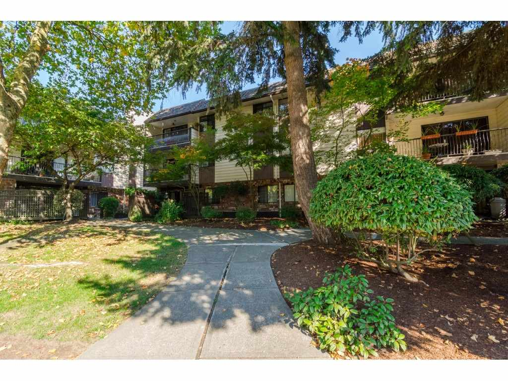 Condo Apartment at 205 7426 138 STREET, Unit 205, Surrey, British Columbia. Image 1
