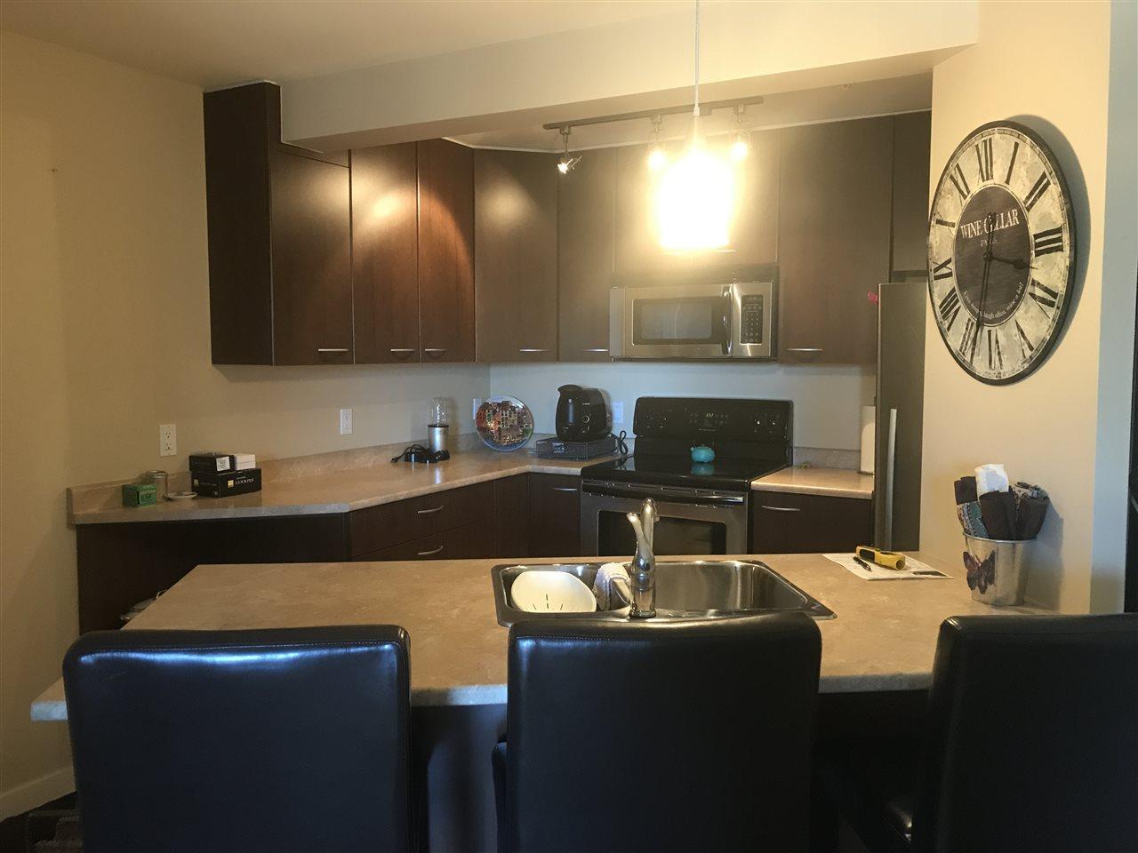 Condo Apartment at 201 5631 INLET AVENUE, Unit 201, Sunshine Coast, British Columbia. Image 1