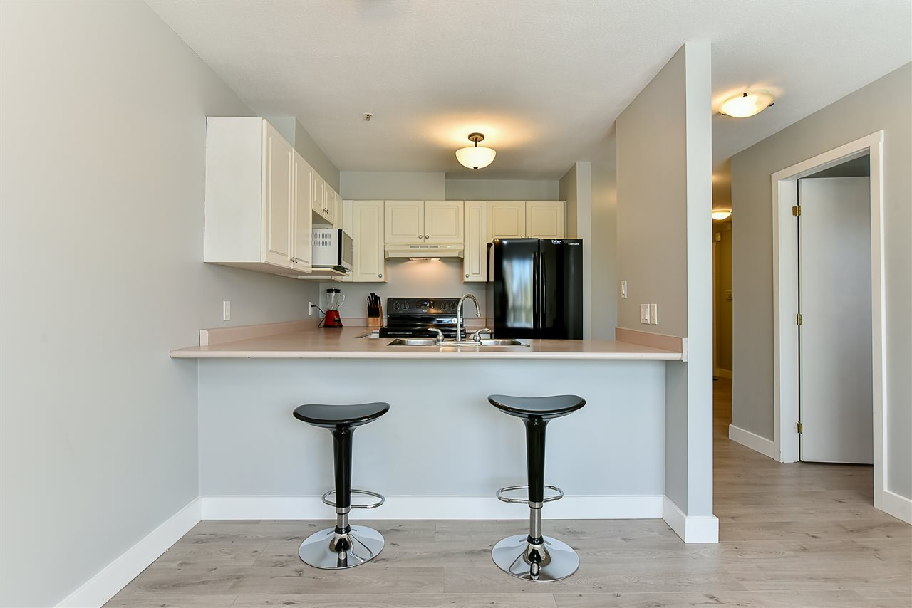 Condo Apartment at 206 7505 138 STREET, Unit 206, Surrey, British Columbia. Image 7
