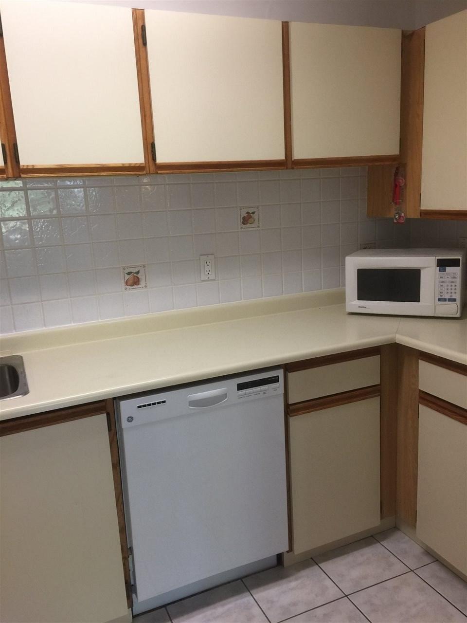 Condo Apartment at 110 10157 UNIVERSITY DRIVE, Unit 110, North Surrey, British Columbia. Image 4
