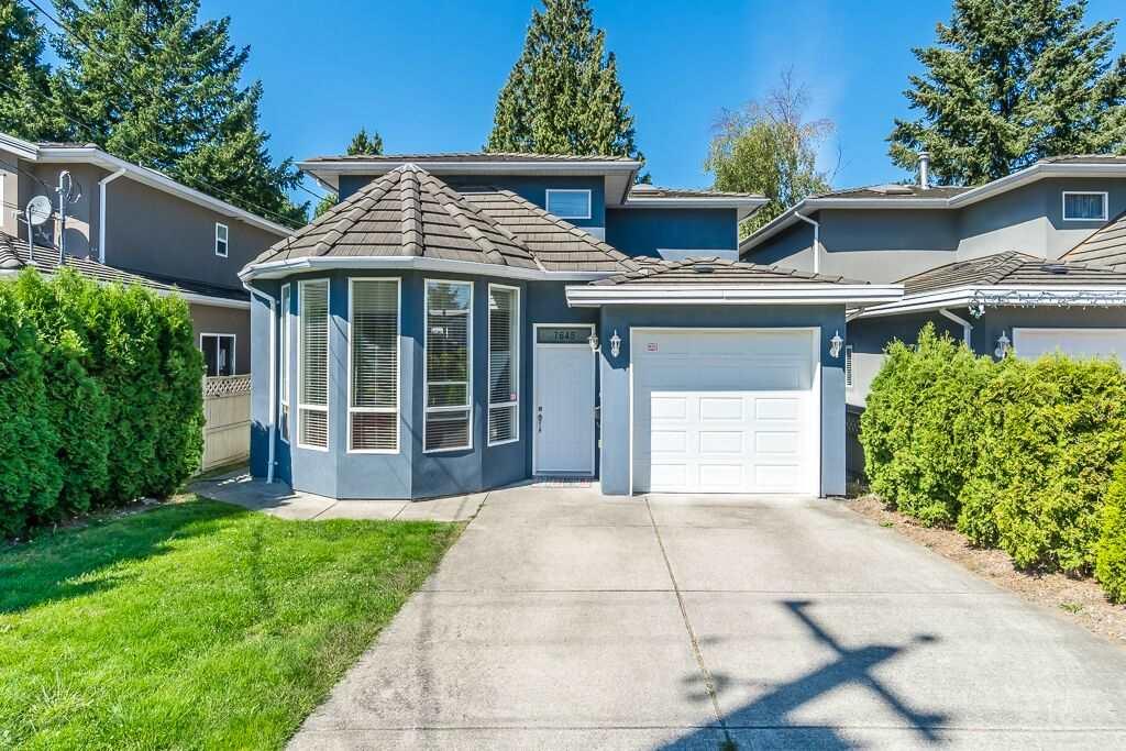 Half-duplex at 7645 ELWELL STREET, Burnaby South, British Columbia. Image 1