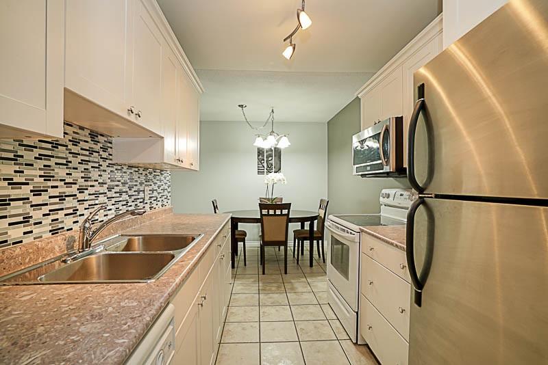 Condo Apartment at 115 13501 96 AVENUE, Unit 115, North Surrey, British Columbia. Image 7