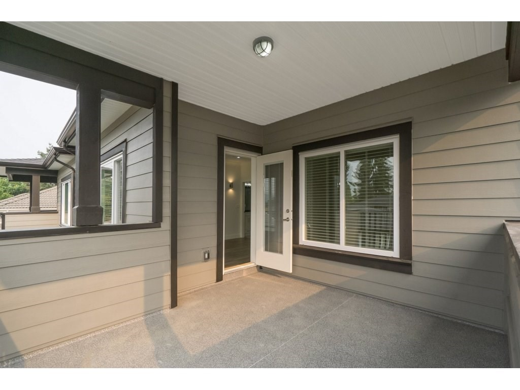 Half-duplex at 8231 16TH AVENUE, Burnaby East, British Columbia. Image 2