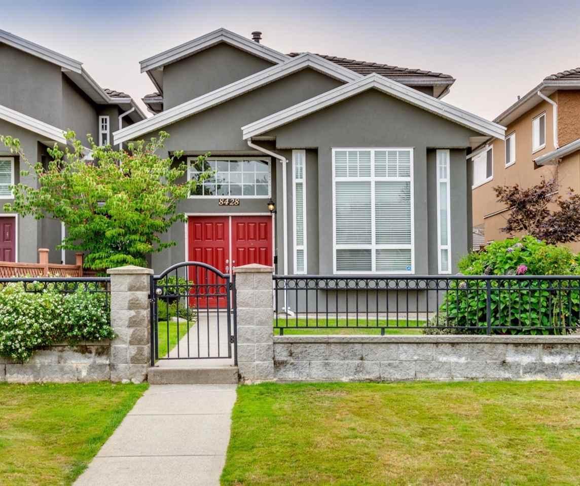 Half-duplex at 8428 14TH AVENUE, Burnaby East, British Columbia. Image 1