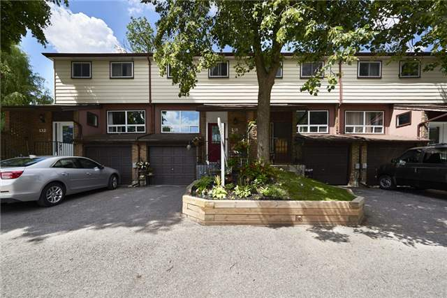 Condo Townhouse at 63 Ferris Lane, Barrie, Ontario. Image 1