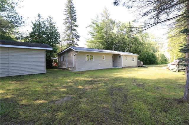Cottage at 5 Difelices Lane, Springwater, Ontario. Image 1