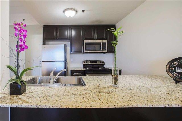 Condo Apartment at 1419 Costigan Rd, Unit 401, Milton, Ontario. Image 2