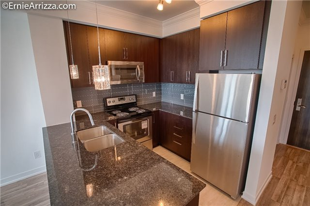 Condo Apartment at 840 Queen's Plate Dr, Unit 1404, Toronto, Ontario. Image 18