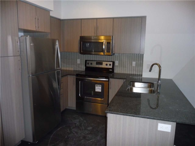 Condo Apartment at 65 Speers Rd, Unit 306, Oakville, Ontario. Image 2