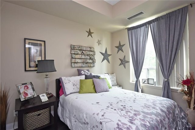 Condo Townhouse at 90 Absolute Ave, Unit 111, Mississauga, Ontario. Image 5