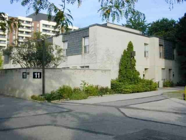 Condo Townhouse at 11 Four Winds Dr, Unit 13, Toronto, Ontario. Image 1