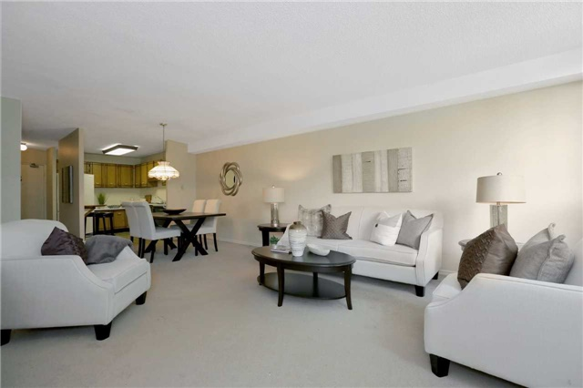 Condo Apartment at 81 Millside Dr, Unit 203, Milton, Ontario. Image 2