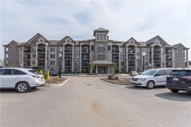 Condo Apartment at 1470 Main St E, Unit 413, Milton, Ontario. Image 1
