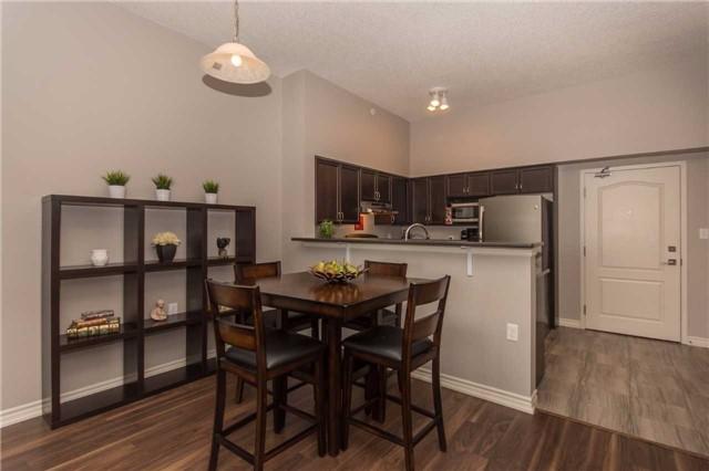 Condo Apartment at 1470 Main St E, Unit 413, Milton, Ontario. Image 2