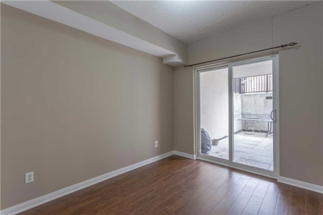 Condo Townhouse at 3035 Finch Ave W, Unit 1001, Toronto, Ontario. Image 2