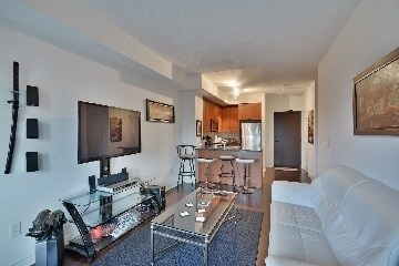 Condo Apartment at 385 Prince Of Wales Dr, Unit 409, Mississauga, Ontario. Image 3