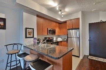 Condo Apartment at 385 Prince Of Wales Dr, Unit 409, Mississauga, Ontario. Image 4
