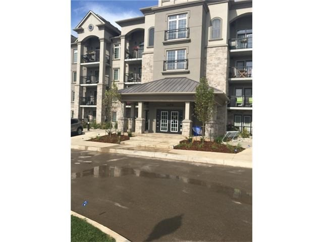 Condo Apartment at 1470 Main St E, Unit 305, Milton, Ontario. Image 1