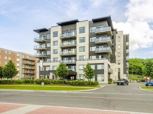 Condo Apartment at 310 Centrum Blvd, Unit 302, Ottawa, Ontario. Image 1