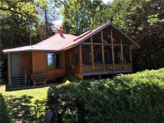 Cottage at 1190 Kashagawigamog Lake Rd, Minden Hills, Ontario. Image 1