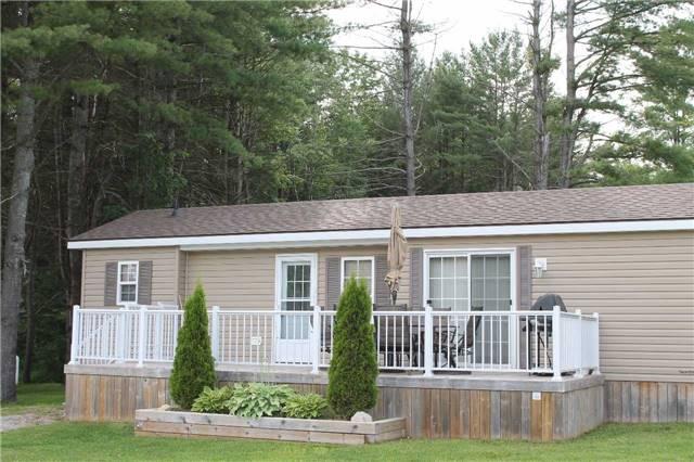 Cottage at 1082 Shamrock Marina Rd, Unit 99, Gravenhurst, Ontario. Image 1