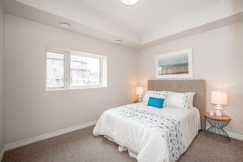 Condo Apartment at 7 Kay Cres, Unit Ll01, Guelph, Ontario. Image 1