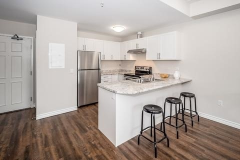 Condo Apartment at 7 Kay Cres, Unit Ll01, Guelph, Ontario. Image 12