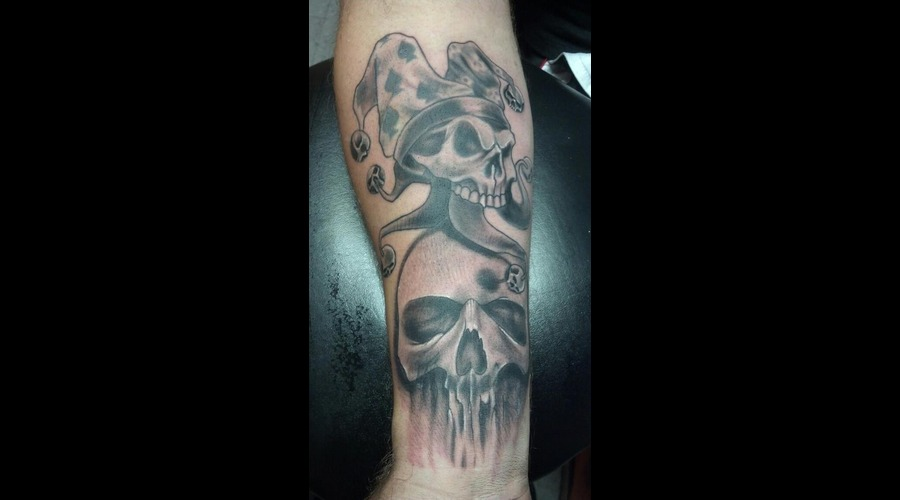 Freehand Skull And Rework Tattoo Black Grey Arm