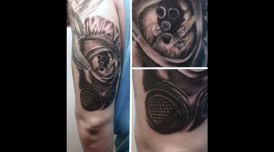 Back Of An Arm  Gas Mask On Child Reflection From Gasmask. Black Grey Arm
