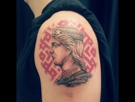 Milda Signs Latvia Face Tattoo Arm