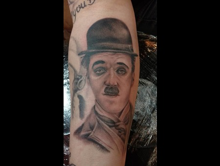 Charle Chaplin Tattoo Portrait Black Grey Arm